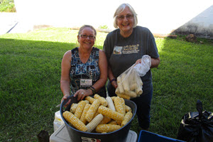 CornShuckingVolunteers300X200